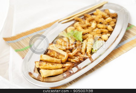 Prawns stock photo, Japanese fried prawns in a steel tray, bamboo mat and chopsticks on white background by fiorellamacor