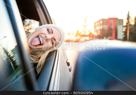 Woman driving a car stock photo, Beautiful young blond woman driving a car by HalfPoint