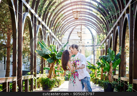 loving couple man and woman kissing in the park stock photo, loving couple man and woman kissing in the park. by timonko
