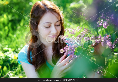 beautiful woman near the lilac tree in the park stock photo, beautiful woman near the lilac tree in the park. by timonko