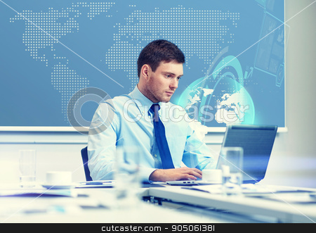 businessman with laptop working in office stock photo, business, people and work concept - businessman with laptop computer and virtual globe hologram in office by Syda Productions