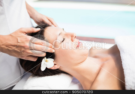 Woman receiving a head massage from masseur stock photo, Close-up of woman receiving a head massage from masseur in a spa by Wavebreak Media