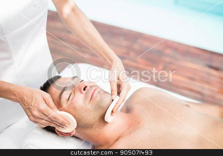 Man receiving a facial massage from masseur stock photo, Man receiving a facial massage from masseur in spa by Wavebreak Media