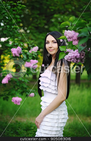 Beautiful woman in the garden of blooming lilacs stock photo, Beautiful woman in the garden of blooming lilacs by timonko