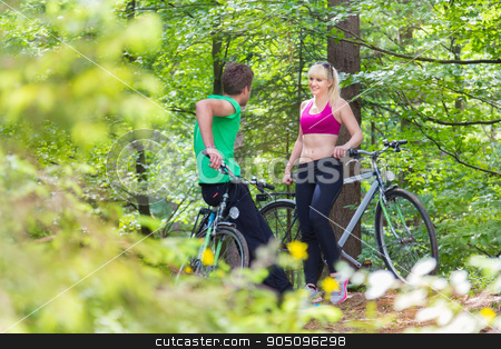 Lifestyle in nature. stock photo, Young spoty active cople biking in nature. Active lifestyle. Activities and recreation outdoors. by kasto