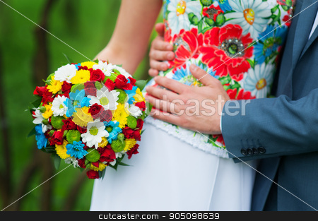 Bride is holding beautiful bright wedding bouquet stock photo, Bride is holding beautiful bright wedding bouquet by timonko