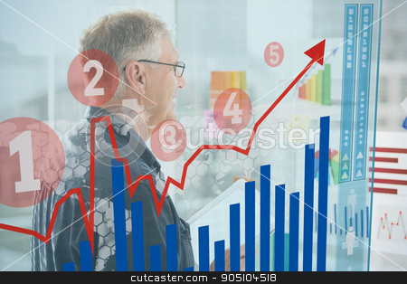 Composite image of graph  stock photo, Graph  against smiling businessman looking flow charts on the wall by Wavebreak Media