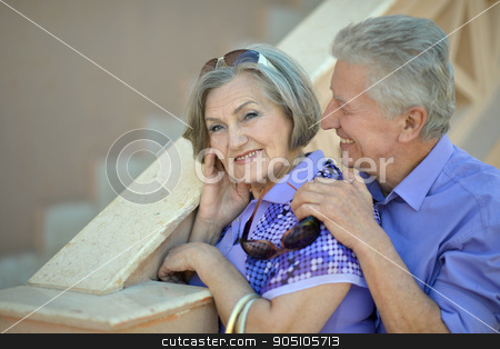 Happy elderly couple stock photo, Happy elderly couple enjoying each other's company by Ruslan Huzau