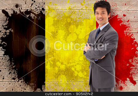 Composite image of portrait of a smiling businessman with the ar stock photo, Portrait of a smiling businessman with the arms crossed against belgium flag in grunge effect by Wavebreak Media