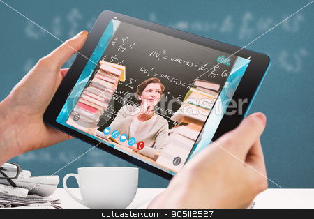 Composite image of hands holding tablet stock photo, Hands holding tablet against blackboard by Wavebreak Media