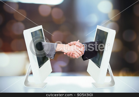 Composite image of close up of two businesspeople shaking their  stock photo, Close up of two businesspeople shaking their hands against fir tree branch with green needles by Wavebreak Media