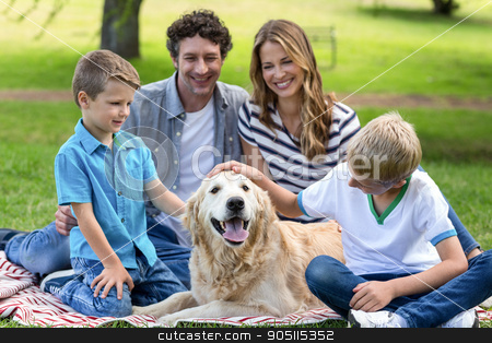 Family with dog in the park stock photo, Family with dog in the park on a sunny day by Wavebreak Media
