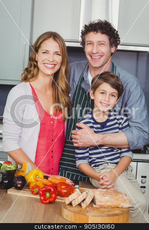 Portrait of smiling parents with son stock photo, Portrait of smiling parents with son in kitchen at home by Wavebreak Media