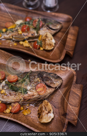 Grilled dorado fish stock photo, Grilled dorado with vegetables preparing by olinchuk