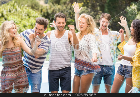 Group of happy friends dancing near pool stock photo, Group of happy friends dancing near pool on sunny day by Wavebreak Media