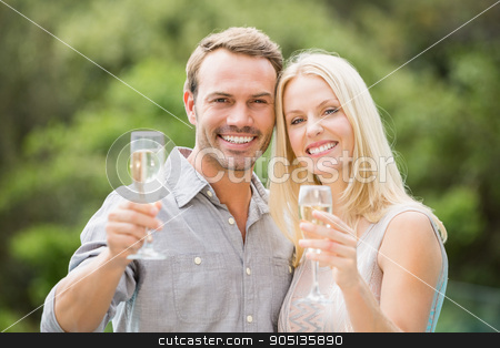 Smiling couple holding champagne flutes  stock photo, Portrait of smiling couple holding champagne flutes  by Wavebreak Media