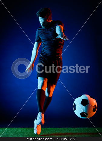 Soccer player Man isolated stock photo, one caucasian Soccer player Man isolated on black backgound by Ishadow