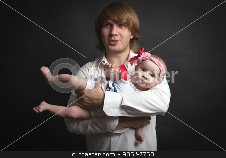 Father and his newborn baby daughter stock photo, Portrait of a father and his newborn baby daughter on a black background by Demkat