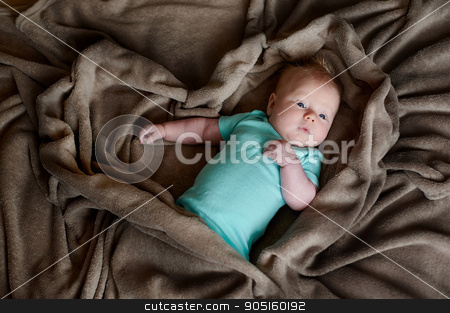 child little boy is lying in bed under a brown blanket stock photo, child little boy is lying in bed under a brown blanket by timonko