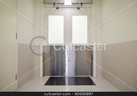 doors at hospital or laboratory corridor stock photo, medicine, science, health care, emergency and interior concept - doors at hospital or laboratory corridor by Syda Productions