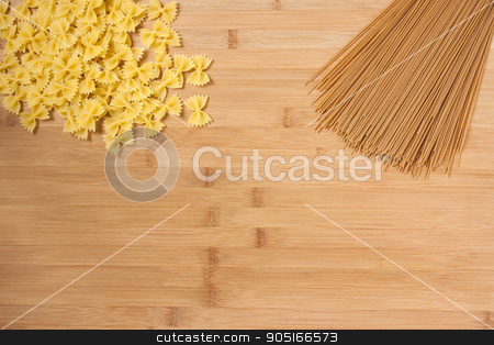 Dry Pasta  stock photo, Dry uncooked pasta on a wooden background.  by AntoniaLorenzo