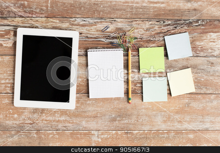 close up of notebook, stickers and tablet pc stock photo, business, education, objects and technology concept - close up of notebook, tablet pc and stickers on table by Syda Productions