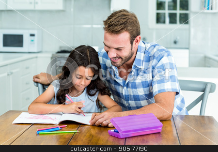 Father looking at daughter while drawing in book stock photo, Father looking at daughter while drawing in book at home by Wavebreak Media