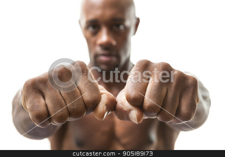 Man Showing Fists and Knuckles stock photo, Muscular man of African descent isolated over a white background showing a closeup of his fists and knuckles.  Shallow depth of field by Todd Arena