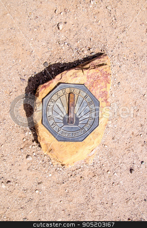 Sun Dial stock photo, Sun dial on rock in the Arizona desert by emattil