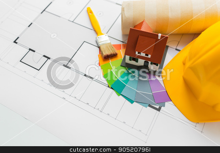 close up of house blueprint with building tools stock photo, architecture, building, construction, real estate and home concept - close up of living house model on blueprint with repair tools by Syda Productions