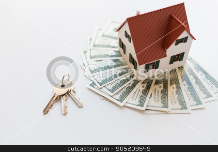 close up of home model, money and house keys stock photo, mortgage, investment, real estate and property concept - close up of home model, dollar money and house keys by Syda Productions