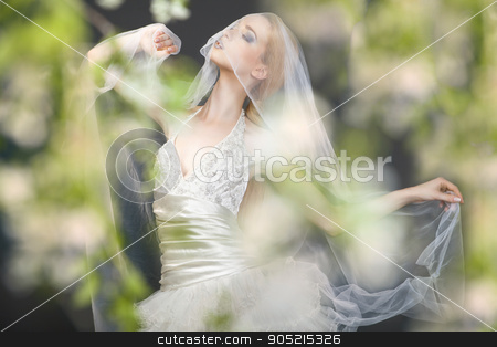 Close up of dreamy beautiful blonde bride stock photo, Close up of dreamy beautiful blonde bride walking alone in the park enjoying wind wave and dance by Isaeva Iuliia