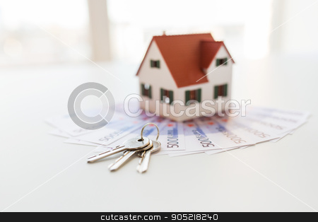 close up of home model, money and house keys stock photo, mortgage, investment, real estate and property concept - close up of home model, money and house keys by Syda Productions