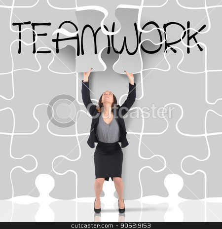 Puzzle teamwork stock photo, Woman enters a big missing puzzle piece by Federico Caputo