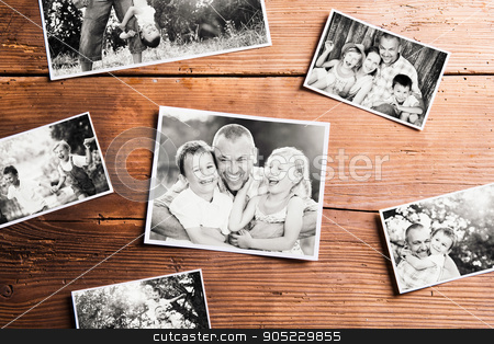 Fathers day composition. Black-and-white pictures, studio shot stock photo, Fathers day composition. Various black-and-white family pictures. Studio shot on wooden background by HalfPoint