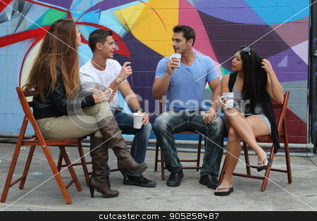Break Time stock photo, Four friends sitting together during a brake drinking coffee. by Henrik Lehnerer