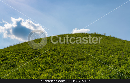 field of grass and perfect blue sky stock photo, Peaceful green mountains covered of grass under the blue sky by StepStock