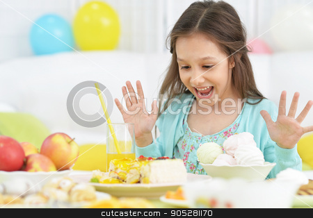 Happy  little girl  with cake stock photo, Happy  little girl  with cake at birthday party by Ruslan Huzau