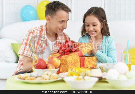 Happy  children  with cake stock photo, Happy  children  with cake and gift at birthday party by Ruslan Huzau