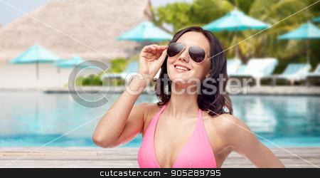 d1a551d839463 happy woman in sunglasses and bikini on beach stock photo