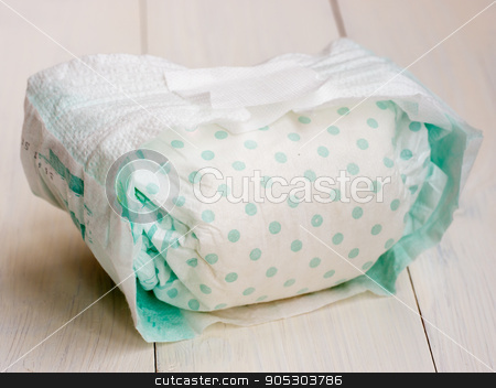 dirty diaper on white wooden background stock photo, dirty diaper on white wooden background, selective focus by Fascinadora