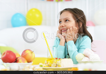 Happy  little girl  with cake stock photo, Happy  little girl  with cake at birthday party by Ruslan Huzau