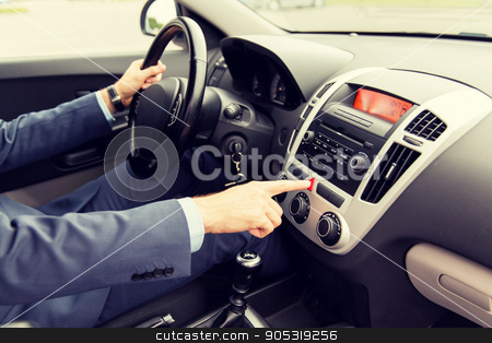 close up of man driving car and emergency button stock photo, transport, business trip, breakdown, technology and people concept - close up of young man in suit driving car and switching emergency signal button by Syda Productions
