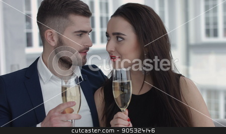 Couple toasting with champagne in the restaurant stock photo, Couple toasting with champagne in the restaurant by mykhalets
