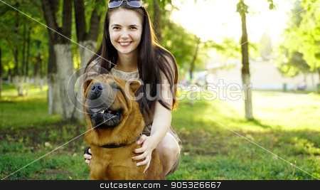young woman walking in the park with a Shar-Pei stock photo, young woman walking in the park with a Shar-Pei by petr zaika