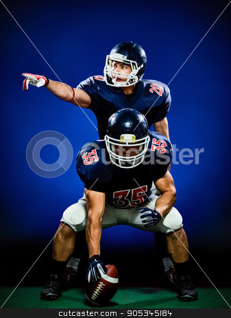 american football players men isolated stock photo, two american football players men isolated on colorful black background by Ishadow