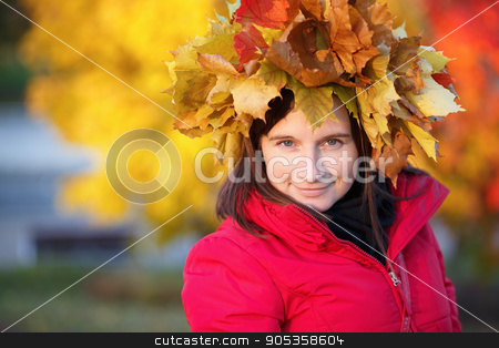 Woman with a wreath of maple leaves stock photo, Portrait of a pretty young woman with a wreath of yellow autumn maple leaves on the head. Selective focus on model. by Veresovich