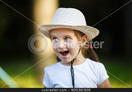 Happy baby girl stock photo, Happy baby girl in white hat outdoors. Shallow depth of field. Selective focus. by Veresovich