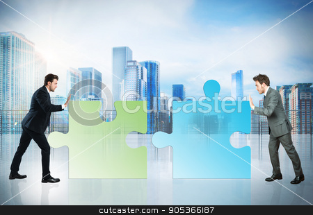 Business partner stock photo, Businessmen push a pieces of puzzle fit together by Federico Caputo