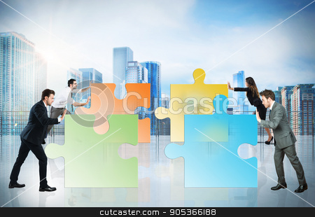 Concept of teamwork and partnership with businesspeople and puzzle stock photo, Concept of teamwork and partnership. Businesspeople pushing pieces of puzzle fit together by Federico Caputo